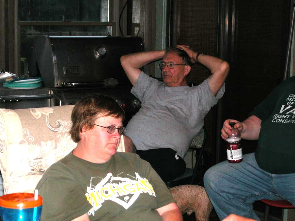 Here a tired Sandy (K8VOJ) relaxes while Larry (KC8KVR) and Barton (N8XQH) unwind.